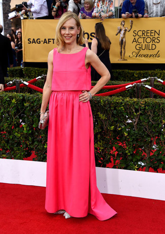How to wear: hot pink evening dress, white leather pumps, silver embellished clutch