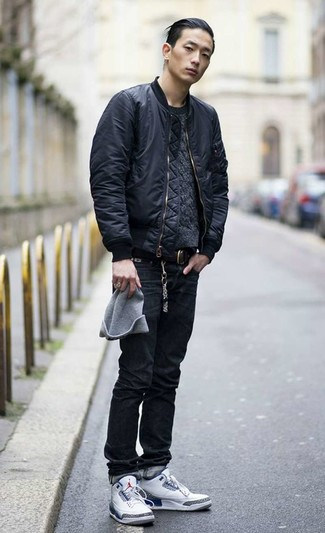 How to wear: white high top sneakers, black jeans, charcoal cable sweater, black bomber jacket