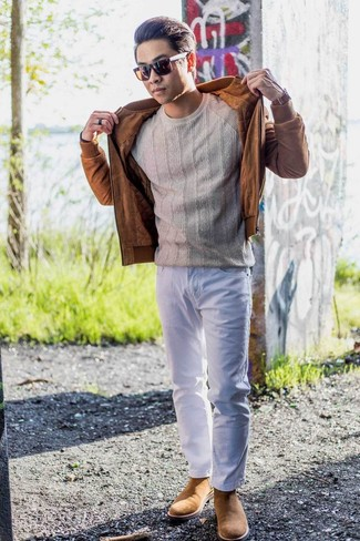 How to Wear Tan Suede Chelsea Boots For Men: The versatility of a tobacco suede bomber jacket and white jeans means they will stay on constant rotation in your closet. To add elegance to your look, round off with a pair of tan suede chelsea boots.