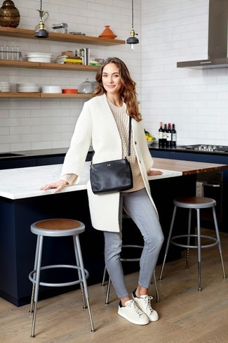 How to wear: white and black leather low top sneakers, grey jeans, beige cable sweater, white coat