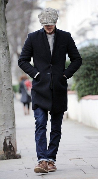 How to wear: brown leather casual boots, navy jeans, white cable sweater, black overcoat