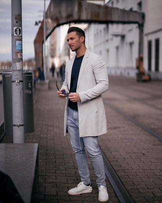 How to Wear a Navy Cable Sweater For Men: This is definitive proof that a navy cable sweater and light blue ripped jeans look amazing when you pair them up in a casual look. If you want to immediately level up this ensemble with shoes, add a pair of white leather low top sneakers to this look.