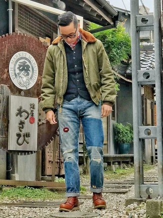How to wear: brown leather work boots, blue ripped jeans, black cardigan, olive bomber jacket