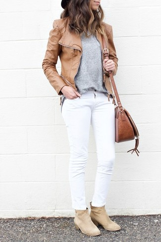 How to wear: beige suede ankle boots, white jeans, grey crew-neck sweater, tan leather biker jacket