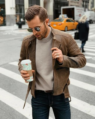 How to wear: dark brown leather belt, navy jeans, grey crew-neck sweater, brown leather biker jacket