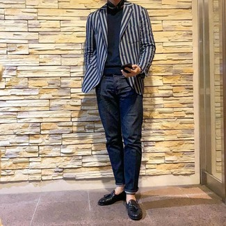How to wear: black leather tassel loafers, navy jeans, navy crew-neck sweater, navy vertical striped blazer
