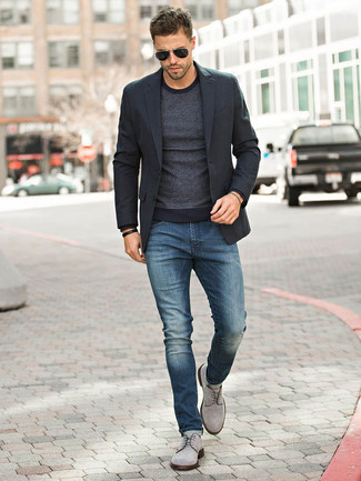 Men's Looks & Outfits: What To Wear In 2020: One of the smartest ways for a man to style such a functional item as a black blazer is to pair it with navy jeans. Why not add grey suede derby shoes to your look for an added touch of style?