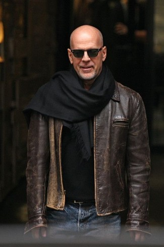 How to wear: black scarf, blue jeans, black crew-neck sweater, dark brown leather bomber jacket
