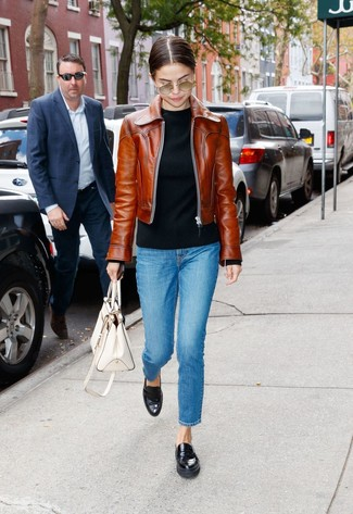 How to wear: black leather loafers, blue jeans, black crew-neck sweater, brown leather bomber jacket