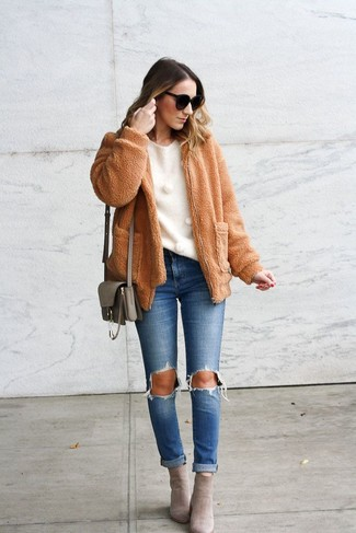 How to wear: grey suede ankle boots, blue ripped jeans, white crew-neck sweater, tan fleece bomber jacket