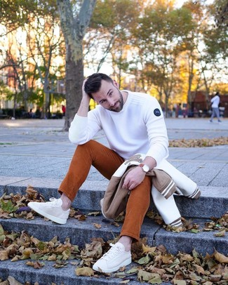 How to wear: beige canvas low top sneakers, tobacco corduroy jeans, white crew-neck sweater, white and brown bomber jacket