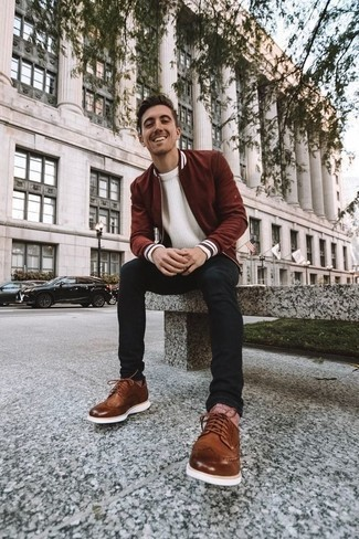 How to Wear Brown Leather Brogues: Hard proof that a burgundy bomber jacket and black jeans look amazing when worn together in a laid-back outfit. Take a more polished approach with shoes and introduce a pair of brown leather brogues to the equation.