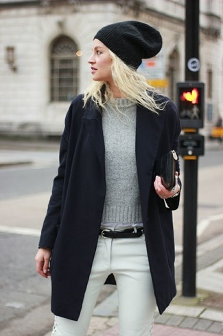 How to wear: black leather clutch, white jeans, grey crew-neck sweater, black coat