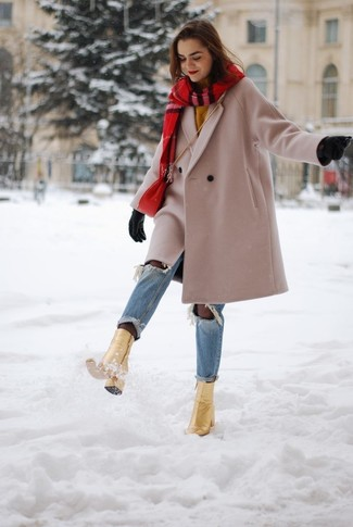 How to wear: gold leather ankle boots, light blue ripped jeans, mustard crew-neck sweater, beige coat
