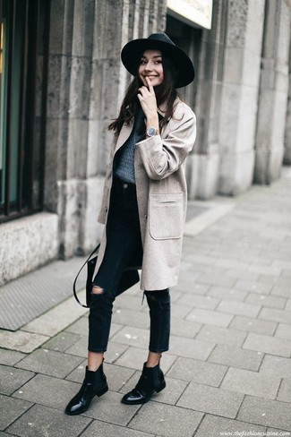 How to Wear Black Leather Chelsea Boots For Women: For a look that's super simple but can be modified in a great deal of different ways, team a grey coat with black ripped jeans. Grab a pair of black leather chelsea boots and you're all set looking stunning.