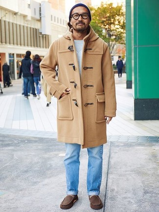Which Jeans To Wear With a White Crew-neck Sweater For Men: Pair a white crew-neck sweater with jeans to demonstrate you've got expert menswear prowess. Dark brown leather driving shoes act as the glue that will tie your getup together.