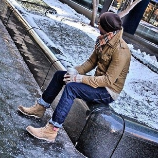 How to wear: tan leather brogue boots, navy jeans, grey crew-neck sweater, brown leather field jacket