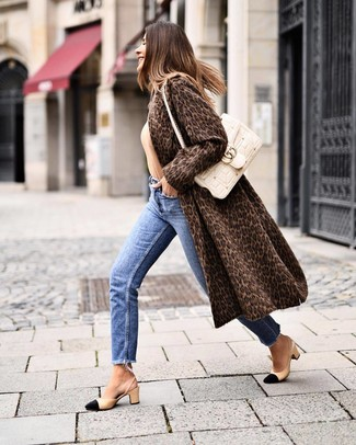 How to wear: black and tan leather pumps, blue jeans, tan crew-neck sweater, dark brown leopard fur coat