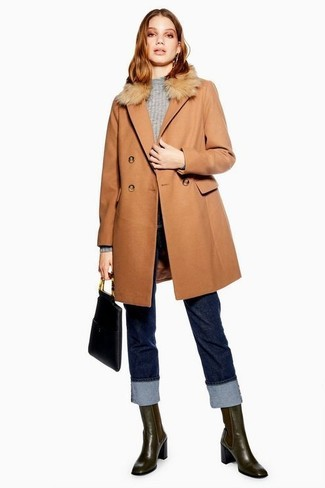 How to wear: dark brown leather chelsea boots, navy jeans, grey crew-neck sweater, tan fur collar coat