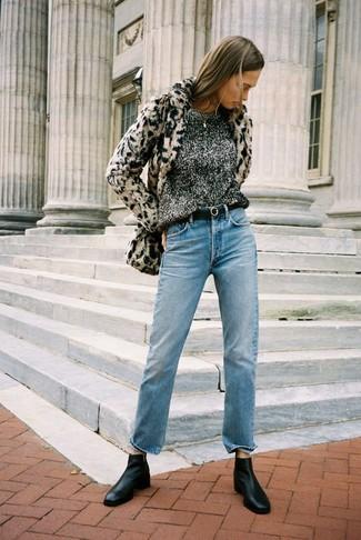 How to wear: black leather chelsea boots, light blue jeans, charcoal crew-neck sweater, beige leopard fur jacket