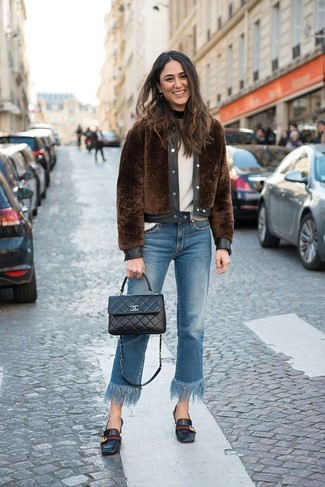 How to Wear a White Crew-neck Sweater For Women: Choose a white crew-neck sweater and blue fringe jeans for a casual and stylish getup. Add black leather loafers to the equation to instantly dial up the glam factor of this outfit.