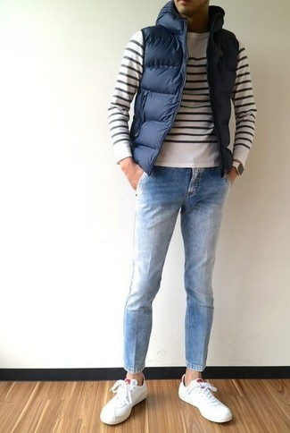 How to wear: white leather low top sneakers, light blue jeans, white and black horizontal striped crew-neck sweater, navy quilted gilet