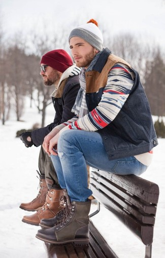 How to Wear a Navy Gilet For Men: A navy gilet and blue ripped jeans worn together are a perfect match. Up the classiness of this ensemble a bit by finishing with dark brown leather casual boots.