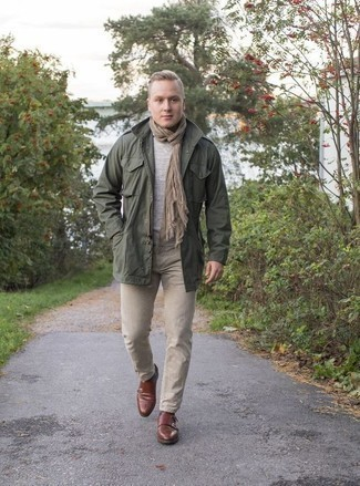 How to Wear a Dark Green Military Jacket For Men: This combo of a dark green military jacket and khaki jeans is clean, seriously stylish and super easy to copy. For maximum impact, complete your look with a pair of brown leather double monks.
