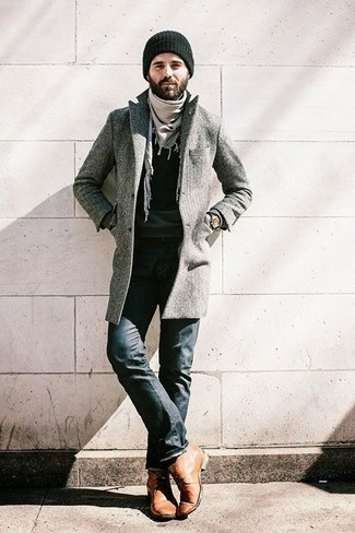 How to wear: tan leather desert boots, black jeans, black crew-neck sweater, grey overcoat