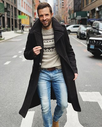 How to wear: tan suede chelsea boots, light blue jeans, grey fair isle crew-neck sweater, black overcoat
