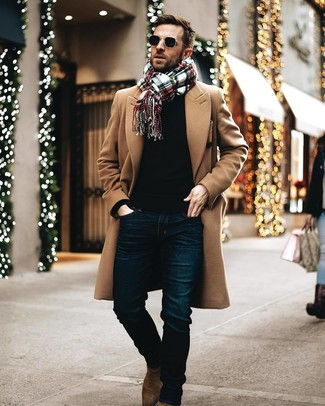 How to wear: brown suede chelsea boots, navy jeans, black crew-neck sweater, camel overcoat