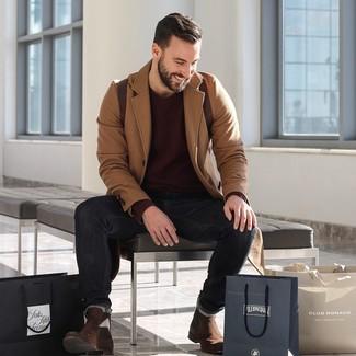 How to wear: dark brown suede chelsea boots, black jeans, burgundy crew-neck sweater, camel overcoat