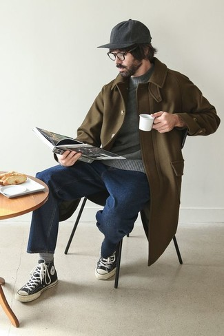 Men's Looks & Outfits: What To Wear In 2020: Teaming an olive overcoat with navy jeans is an on-point idea for a casually neat outfit. Finishing off with a pair of black and white canvas high top sneakers is a surefire way to inject a hint of stylish effortlessness into this ensemble.
