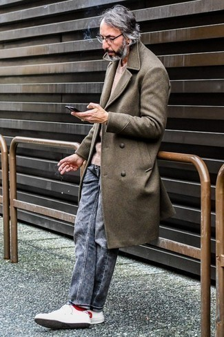 How to Wear a Beige Crew-neck Sweater For Men: A beige crew-neck sweater and grey jeans are a smart combo worth having in your current routine. Our favorite of a ton of ways to complement this ensemble is with a pair of white and red leather low top sneakers.