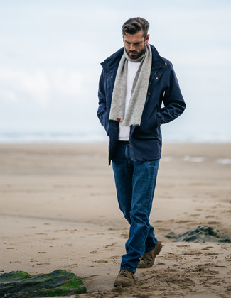 How to wear: olive suede desert boots, blue jeans, white crew-neck sweater, navy parka