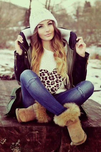 How to wear: tan uggs, blue jeans, white leopard crew-neck sweater, olive parka