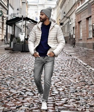 How to Wear a Navy Crew-neck Sweater For Men: You'll be surprised at how super easy it is for any gent to get dressed like this. Just a navy crew-neck sweater and grey jeans. Now all you need is a nice pair of white canvas low top sneakers.