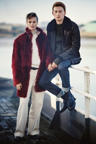 How to wear: black leather casual boots, navy jeans, black crew-neck sweater, black shearling jacket