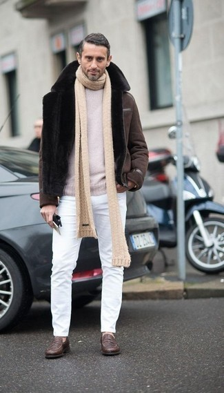 How to Wear a Brown Shearling Jacket For Men: A brown shearling jacket and white jeans are a combination that every smart guy should have in his casual arsenal. If you want to effortlessly amp up your look with one item, add brown leather loafers to the mix.
