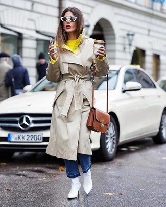 How to Wear a Brown Leather Crossbody Bag: A beige trenchcoat and a brown leather crossbody bag are among the fundamental pieces of a great casual arsenal. Add a pair of white leather ankle boots to this getup to instantly change up the outfit.