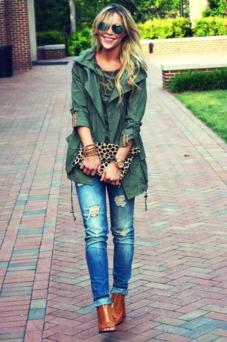 How to wear: tobacco cutout leather ankle boots, blue ripped jeans, dark green camouflage crew-neck t-shirt, dark green anorak
