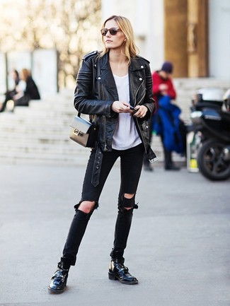How to wear: black leather lace-up flat boots, black ripped jeans, white crew-neck t-shirt, black leather biker jacket