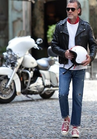 How to wear: red and white low top sneakers, blue ripped jeans, white crew-neck t-shirt, black leather biker jacket