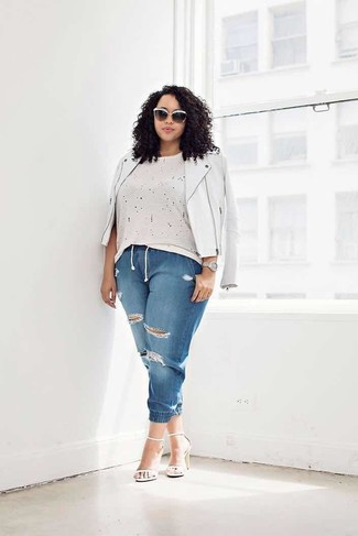 How to wear: white leather heeled sandals, blue ripped jeans, beige crew-neck t-shirt, white leather biker jacket