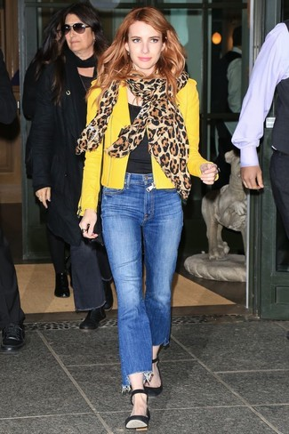 Emma Roberts wearing Black Suede Pumps, Blue Jeans, Black Crew-neck T-shirt, Yellow Leather Biker Jacket
