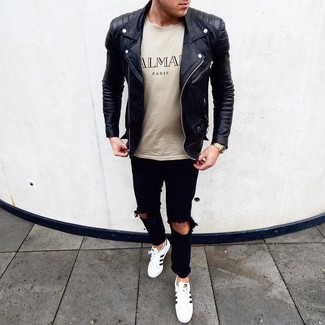 How to wear: white and black leather low top sneakers, black ripped jeans, beige print crew-neck t-shirt, black leather biker jacket