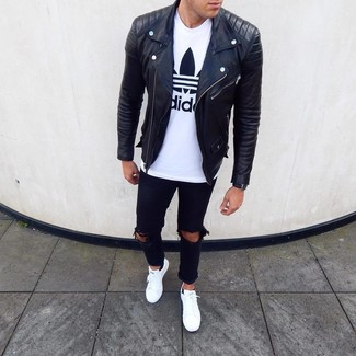 How to wear: white leather low top sneakers, black ripped jeans, white and black print crew-neck t-shirt, black leather biker jacket