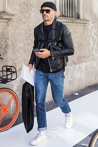 Fashion for Men Over 40: What To Wear: Consider wearing a black leather biker jacket and blue jeans for standout menswear style. If you're on the fence about how to round off, a pair of white leather low top sneakers is a surefire option.