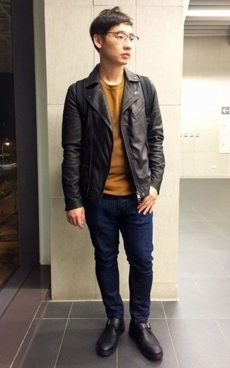 How to Wear Black Leather Monks: A black leather biker jacket and navy jeans are a cool combo that will carry you throughout the day and into the night. For something more on the classy side to finish off this outfit, complement this ensemble with black leather monks.