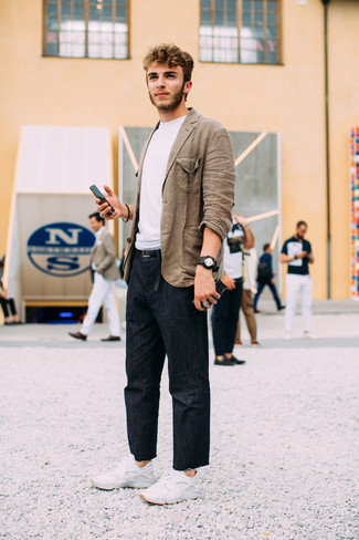 How to wear: white athletic shoes, navy jeans, white crew-neck t-shirt, brown linen blazer